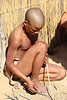 !Xaus Lodge - Bushman Village Visit - Young Man Making Crafts