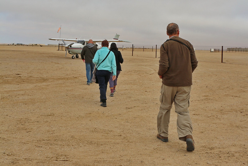 Flight Over Namib Naukluft Park - Walking Out to the Plane