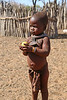 Himba Village Visit - Child with Apple