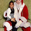 "My 4 year old daughter Alaina enjoyed seeing Santa at The Rockingham mall and she was also showing her Market Basket pride with her giraffe ""Artie"".<br /> <br /> Tiana Garvin"
