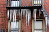 Icicles hanging from a fire escape on Free St