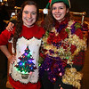 Westford Funfest's Festival of Trees at the Westford Regency Inn invited people to an Ugliest Holiday Sweater contest. Bromfield School students Rebecca Morin, left, and Samantha Bessette, both 17 and from Harvard, looked hard to beat for the ugliest sweater, in the ones they wore to watch their friends from Bromfield School perform. (SUN/Julia Malakie)