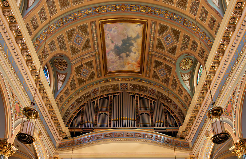 Organ by Murray Harris, Restored by Wicks Organ Company  From the Saint Jean Baptiste website, number XX:  The choir contains the console which controls the Murray Harris/Wicks pipe organ in the upper balcony, a generous gift of the church's donor, Thomas Fortune Ryan.  Built in 1913, it is perhaps the last instrument designed by Murray Harris.  In November 1999, the Wicks Organ Company of Highland, Illinois, was contracted to rebuild, augment, and update the organ which had become unplayable in the 1990s.  The project cost in excess of one million dollars.  The Murray Harris/Wicks pipe organ was dedicated in February 2001 by Todd Wilson.  It contains eleven divisions, playable from a four manual console; 122 stops, 71 ranks of pipes, 14 pipe extensions, 44 digital stops, 57 digital ranks, and a total of 4,204 pipes.