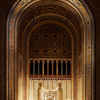 """Temple Emanu-El Ark, Mosaic by  Hildreth Meière <br><br> From a pdf file from the <a href=""""http://www.emanuelnyc.org/simple.php/about_tour"""">Temple Emanu-El website:</a>  <br><br> """"As in the tradition, Temple Emanu-El's ark is located on the eastern wall of the sanctuary, facing Jerusalem. Emanu-El's ark was designed to depict an open Torah scroll, with the side pillars representing staves (atzei chayim) and the finials atop servicing as the scroll decorations (rimonim). The gates become the open scroll with the depiction of the Tablets of the Law set in the center. Emanu-El's """"Torah within a Torah"""" gives added meaning to the phrase from Pirkei Avot, """"Turn the Torah and turn it again for everything is in it."""" The distinctive glass-and-marble mosaic arch that frames the bimah was deigned by Hildreth Meière-one of the very few women whose achievements gained the recognition of the established art world during the first half of the 20th century. The work was executed by Ravenna Mosaics of Berlin, whose skilled personnel hand laid the millions of tiles that make up Meiere's designs.""""  Hildreth Meière (1892-1961) was one of the most influential and creative decorative artists of the 20th century  and ranks with a small number of women artists whose achievements gained the recognition of the art world in the first half of the century according to the <a href=""""http://www.hildrethmeiere.com""""> International Hildreth Meiere Association website.</a>  She was born in New York  City. After studying in Florence and exposed to the Renaissance masters, she said """"After that I could not be satisfied with anything less than a big wall to paint on. I just had to be a mural painter,"""" according to <a href=""""http://en.wikipedia.org/wiki/Hildreth_Meiere""""> Wikipedia.</a>  She continued her studies at the Art Students League of New York, the School of the Art Institute of Chicago, New York School of Applied Design for Women. She served as a draftsman in the U.S. Navy during World War I after t"""