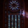 """Temple Emanu-El Rose Window by Oliver Smith <br><br> From a pdf file from the <a href=""""http://www.emanuelnyc.org/simple.php/about_tour"""">Temple Emanu-El website:</a>  <br><br> """"Most prominent of the stained-glass windows featured on the sanctuary's western façade is Oliver Smith's rose or wheel window, which is replete with numerical strategies that are a subtext of Jewish mysticism. Emanu-El's """"signature"""" window is comprised of 12 panes (symbolic of the tribes of Israel) surrounding a six-pointed Magen David (or Star of David). Circling the rose are 36 small panes-36 being significant because of the Talmudic reference to 36 righteous men in each generation who are responsible for preserving the world; 36 also signifies """"double life"""" in gematria (numerology of the Hebrew language and alphabet) because 2 X 18 = 36 and 18 is the numerical value of the Hebrew word chai, which means """"life."""" The rose window was donated to the congregation in honor of Babette and Mayer Lehman by their children, who included New York Supreme Court Justice Irving Lehman (a former Emanu-El president) and New York Governor Herbert Lehman (the first Jewish governor of New York). <br><br> Caai likewise is symbolized in the 18 marquis-shaped panes that arch around the rose and four lancet windows (each of which have 10 panes). The 18 panes of the arch may suggest the Amidah, our 18-part daily prayer. The seven windows located at the top imitate the seven-branched menorahs on the bimah. The center high window of the seven was donated to the congregation by Florette Guggenheim-widow of Benjamin Guggenheim (who died aboard Titanic), mother of arts patron Peggy Guggenheim and daughter of Joseph Seligman (a member of the Seligman banking family and a long-time vice president of the congregation.""""  <br><br> According to the <a href=""""http://www.rodephsholom.com/index.php?option=com_content&view=article&id=159&Itemid=155"""">Congregation Rodeph Sholom website, </a>  Oliver Smith was a master craftsman in th"""