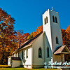 Cerulean autumn skies and blazing orange maple trees frame Saint Williams Catholic Church within northeastern Wisconsin (USA WI Eland)