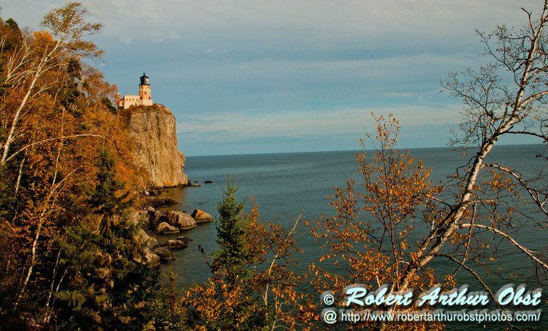 Blazing autumn foliage and bright blue skies frame cliff top Split Rock Lighthouse Minnesota State Historic Site on Lake Superior (USA MN Two Harbors; RAO 2012 Nikon D300s Image 3827)