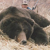 "Guide Don Anderson has a passion for hunting and on occasion gets to hunt himself. Here Don is with his 10 foot 8 inch Alaska Brown Bear he took in 1986 with a 338 Ruger rifle. The bear was less than 20 feet away when taken on the Alaskan Peninsula. This bear was later life-sized and on display at Four Seasons Sporting Goods in San Luis Obispo, California until a room was added to our home to accommodate this beautiful Alaska Brown Bear. Thanks go to Don and Warren Johnson of Bear Lake Lodge for allowing Don the opportunity and privilege to guide over the years as well as being able to add this bear to his personal collection. Hunts are offered exclusively through Anderson Taxidermy & Guide Service, Inc. Contact Don Anderson to inquire about booking your hunt for the new year ahead.  <a href=""http://www.thehuntpro.com"">http://www.thehuntpro.com</a>"