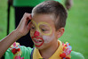 Boy with Clown Face at the Picnic