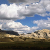 "SPLIT MOUNTAIN.  Utah.  Late September near Dinosaur National Monument.  I saw the clouds from 15 miles away and drove until I liked the landscape beneath them.  To 42"" on long side.  Click on this preview image for a full-screen view."