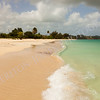 Sunny Tropical Caribbean Beach with Blue Cloudy Sky
