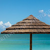 Tropical Seascape of Beach Umbrella by Sea and Sky