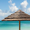 Tropical Seascape of Beach Umbrella and Sky with Clouds
