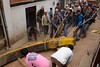 Building Bhairab chariot in preparation of Bisket Jatra:<br /> Beta Sin being pulled with ropes to Taumadhi tole