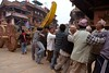 Building Bhairab chariot in preparation of Bisket Jatra:<br /> the base of the chariot is assembled near Nyatapola temple, then is moved near a platform in front of Bhairabnath temple