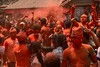 Sindur Jatra: singing and dancing in clouds of orange powder during the festival