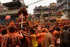 During Sindur Jatra the main square of Thimi is packed with devotees throwing orange powder and roaming with palanquins carrying local gods