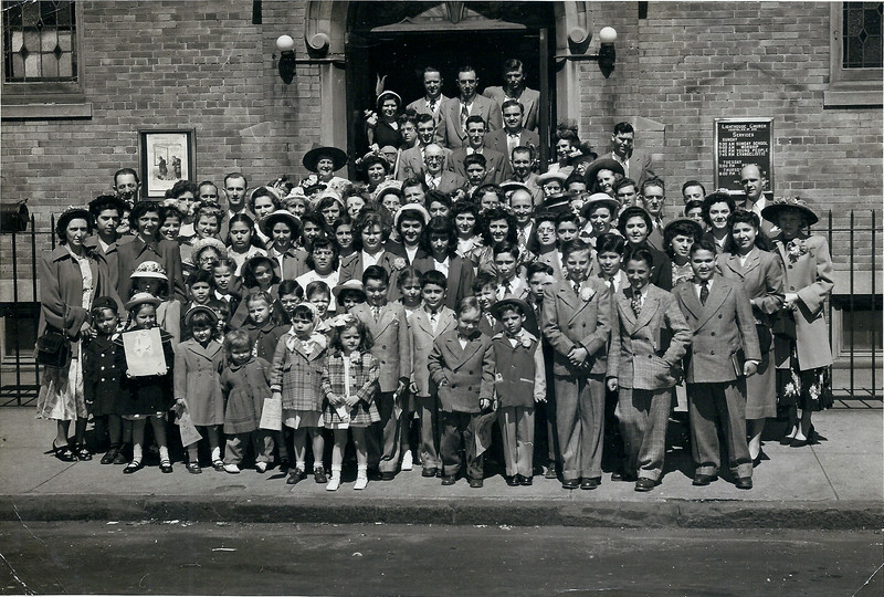 LEFT front: Anne Davis, Jim, Flo  (Whittaker), Dottie Anne. Doug is 2nd row behind girl with kerchief. Dad is LEFT BACK, Mom is RIGHT 5th row down, big hat.