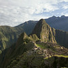 Sunrise view of Machu Picchu from near The Guardhouse located in the citadel's far southwestern corner.  Urubamba River on left. <br /> <br /> Machu Picchu, Cusco Region, Urubamba Province, Peru.