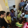 Compassion staff and visitors from the US and UK visit the opening of a new school on the island of La Gonave in Haiti. Jimmy Mellado cuts the ribbon officially opening the school.