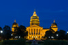 The Iowa State Capital building illuminted at night in Des Moines, Iowa, USA.