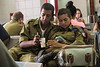 Soldiers and cell phones, the two of the most ubiquitous sights in Israel.<br /> (Eilat bus station, 7/24/14)