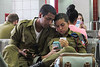 Soldiers and cell phones.<br /> (Eilat bus station, 7/24/14)