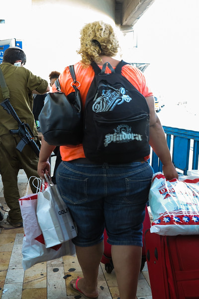 Tel Aviv bus station   (7/24/14)<br /> Lady with the most junk food on the bus from Eilat<br /> #9124