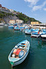 Colorful fishing boats in the bay in Sorrento, Campania, Italy.
