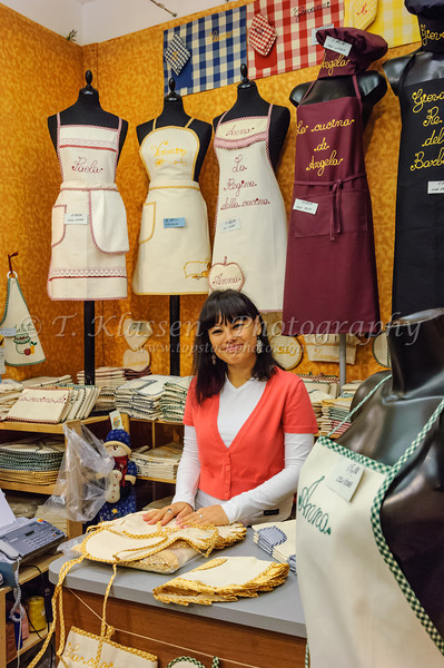 A girl in an apron shop in Venice, Italy.