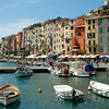 Swimming in the harbor in the picturesque town of Portovenere, on the Ligurian coast of Italy, called the Italian Riviera