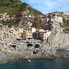 The beautiful town of Manarola, on a hot summer day, in the Cinque Terre, Italy.