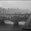 Ponte Vecchio bridge, over the Arno River, in the rain. Florence, Italy