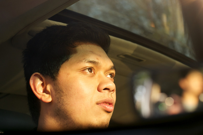 Mahopac, NY, April 15, 2012; Adam Azahari sitting in his car at sunset outside his suburban home, Photo by Adam Azahari © 2012