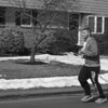 My boyfriend RJ Vitolo, age 23, running past my neighbor's house in Danvers, Mass. on a cold day in March. Photo by Amanda Lake.