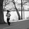 A woman running on the Charles River Esplanade on March 5, 2014. Photo by Pip Stevens.