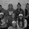 Boston University women's soccer players gather in their locker room after their Patriot League championship victory.