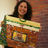 December 6, 2013 - Instructor Mia Schon shows off her final painting at the Paint Bar in Boston.