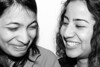 Hena Thakur and Kanupriya Soni laugh through their conversation at their apartment.