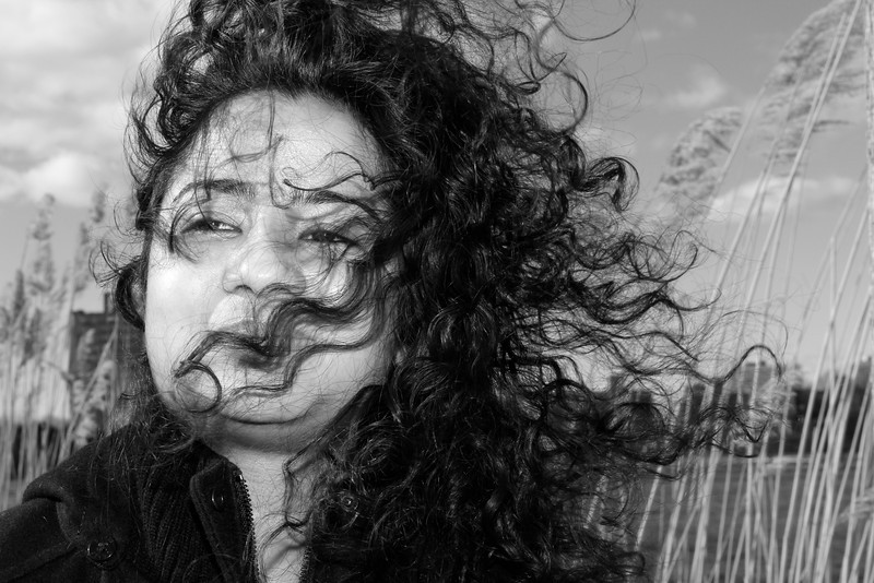Hena Thakur poses for a fill flash portrait on a windy Wednesday on the Esplanade.