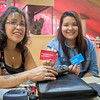 EPL Customers, Vivian and Megan Olson, show off their library cards.<br /> <br /> Taken on July 11, 2014 by James Cadden.