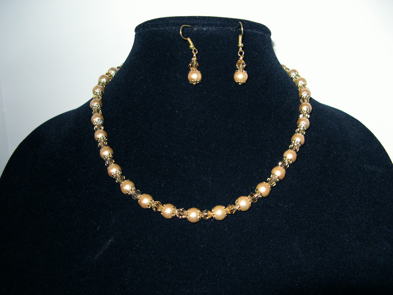 Coffee Crystalazzi Pearls, Gold Plated Spacer beads, and Gold Swarovski Crystal