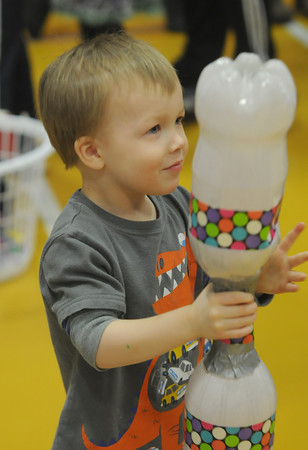 Amesbury: Jameson Mitchel , 3, of Amesbury, makes a tornado with 2 soda bottles at the Family Fun Fair at the Cashman School in Amesbury Saturday. Jim Vaiknoras/staff photo