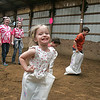 "Jaydhen Koch, 4, of Avon donned a sack and hopped across the indoor corral. Her grandmother, Cheryl Koch of Avon, took her there. ""She loves bunnies and horses,"" said grandma. photo by Chuck Humel"