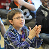 "Zak Jockel rubs his hands to demonstrate friction during the program ""Forces and Motion"" to second-graders at Ely Elementary on April. 8. STEVE MANHEIM/CHRONICLE"