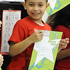 Wilson Gonzalez, a first-grader at Toni Morrison Elementary,  receives a third quarter honor roll academic award. STEVE MANHEIM/CHRONICLE