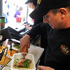 Chef Todd Berry prepares lunch at the KRAV Food Truck. STEVE MANHEIM/CHRONICLE