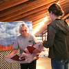Julie Mackey of Ohio State University Extension and a 4-H adviser works with Extension intern Ashley Huffman to help set up for the Lorain County Fair. BRUCE BISHOP/CHRONICLE