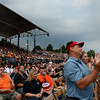 Fans cheer during the Foreigner concert Tuesday evening as a storm rolls in. KRISTIN BAUER | CHRONICLE