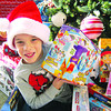 Bobby Miller, 8, is excited to donate the toys he hand picked for this year's Not Forgotten Box toy drive.